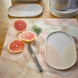 marble cuttting board with peach and yellow oval side plate