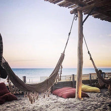 Bohemian hammock with fringes at the beach