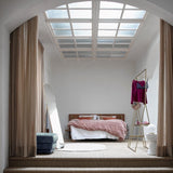 bedroom with open wardrobe and brass colored clothing hangers