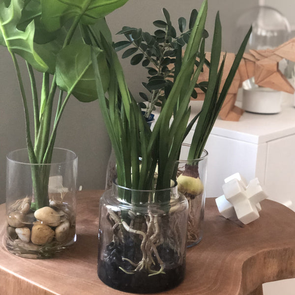 Artificial plant in glass jar