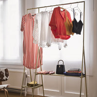 open wardrobe in brass color