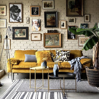 Sofa in family room with gallery wall