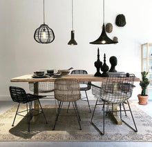 Black metal wire chair in dining room