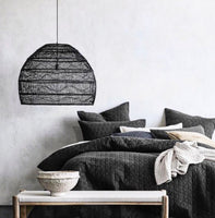 Large black wicker pendant light in bedroom