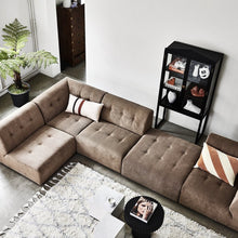 element sofa in brown with black showcase cabinet