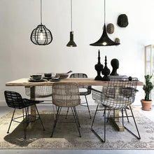 Dining room with all hk living USA chairs and black concrete pendant light fixture