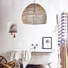 Large handwoven wicker pendant lamp in a bathroom