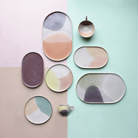 Gallery ceramics in pastel colors and round and oval shapes