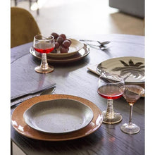 table setting with grey salad plate on a salmon color dinner plate