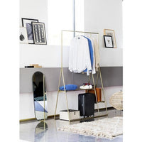 clothing rack with brass clothing hangers