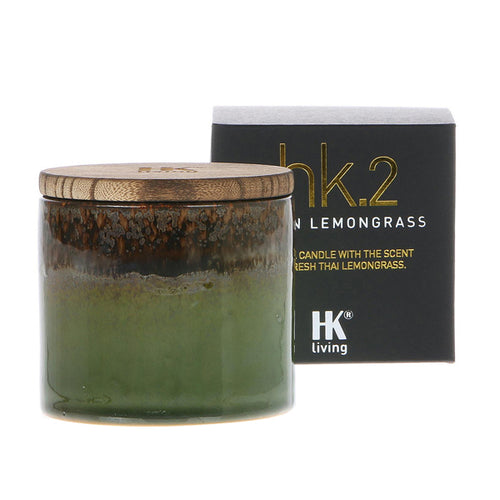 soy candle in green ceramic jar with wooden lit asian lemongrass