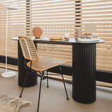 black console table with natural rattan desk chair