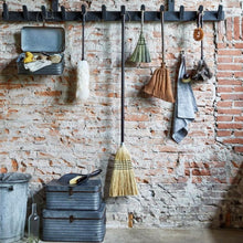 stylish kitchen display with broom and dusting set