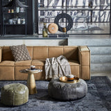 family room with canvas couch in khaki brown and brass side table and army green leather pouf
