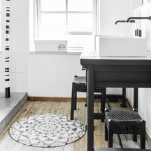 stylish black and white bath room with hk living usa round bath mat
