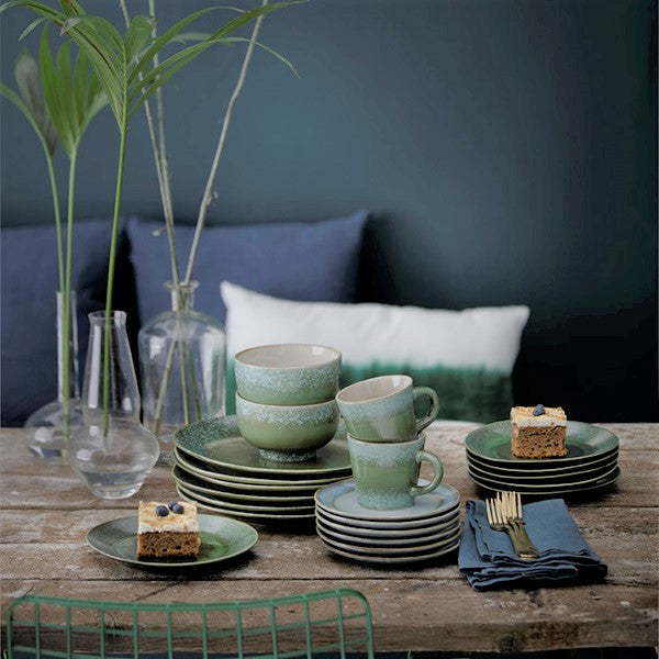stack of green dinner plates