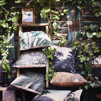 printed cushions in an urban jungle setting
