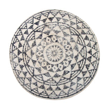 round bath mat with vintage black and white look