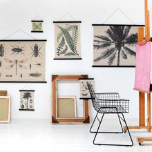 artist studio with cotton wall hangings and empty frames