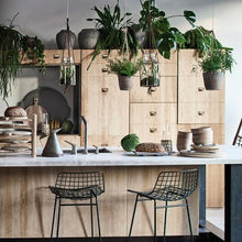 natural kitchen with wooden rack for wooden plates