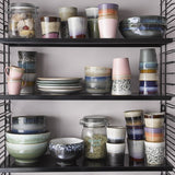 open shelving with 70's ceramics