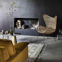 eclectic new bohemian style living room with velvet coauch and natural bohemian braided egg chair