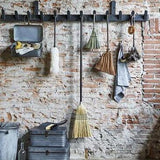 exposed brick wall with brushes