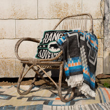 rattan natural chair with hand embroidered cusion