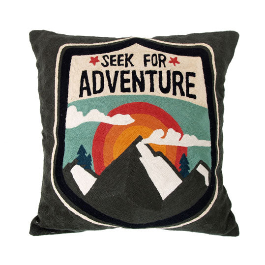 hand embroidered cushion with seek for adventure text and mountain