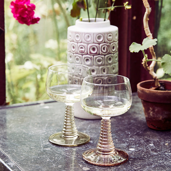 Wine glasses with retro foot in swirl glass