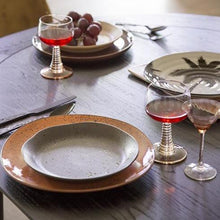 Table setting with wine glasses with swirl foot