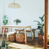 boho style seating area with flat natural wicker pendant lamp