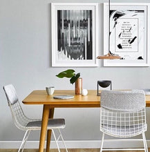 White metal dining chair with grey comfort kit and art works