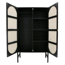 inside of black wooden cabinet with cane woven doors