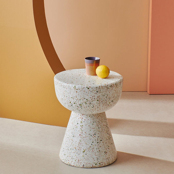 terrazzo side table with pastel colored coffee mug and lemon