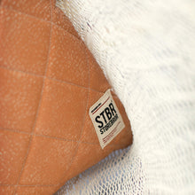 detail of stitched leather cushion