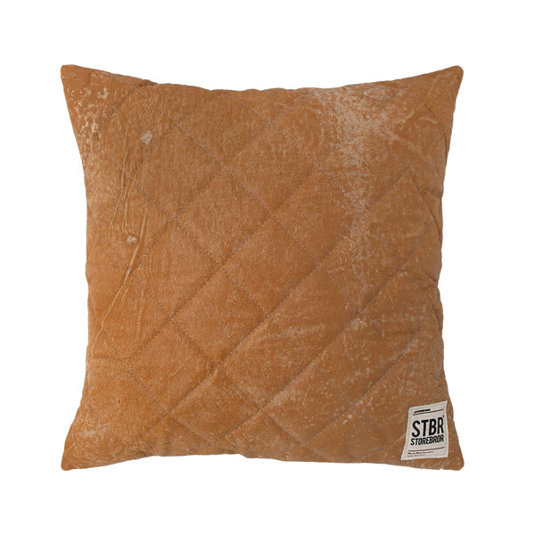 leather quilted cushion with STBR label on right