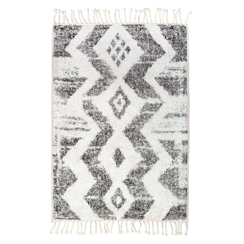 bath mat with zigzag pattern and fringes made of cotton