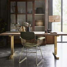 brass metal wire chair with arm rests and table
