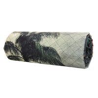 tropical island bedspread rolled up