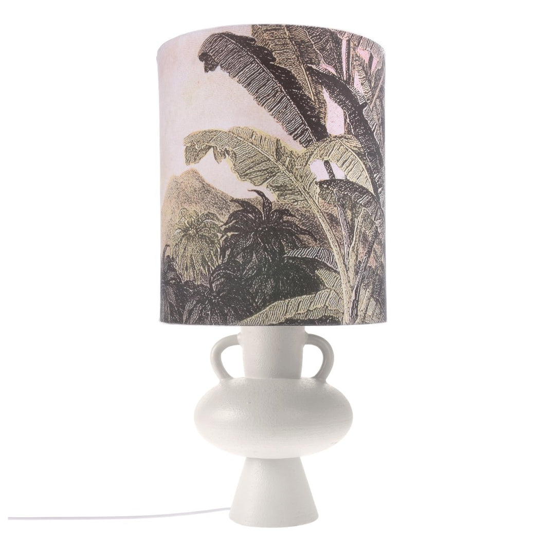 jungle theme lampshade on a large white stoneware base with two handles