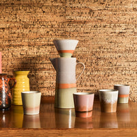 ceramic coffee filter and pot and mugs on wooden table