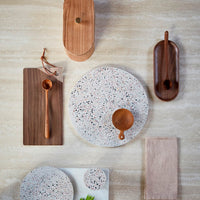 round large terrazzo tray among other beautiful kitchen dispaly goodies
