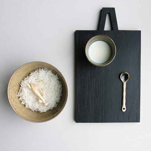 cutting board and ceramic noodle bowl with