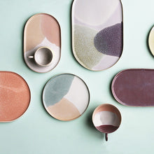 composition of oval and round dinner plates in pastel colors