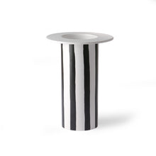 white vase with black stripes