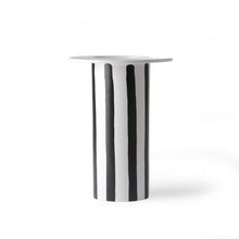 white ceramic vase with black diagonal stripes