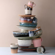 stack of 70's style HK living usa ceramics in varios colors