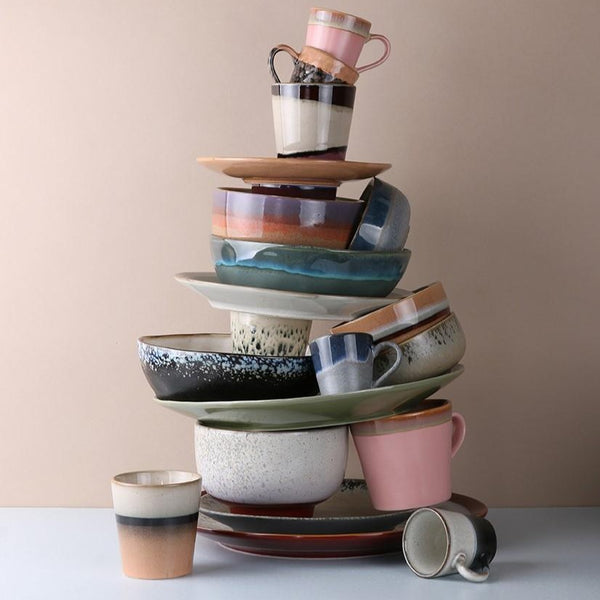 stack of funky ceramics in 70's style
