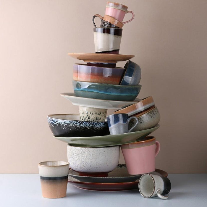 stack of new 2020 collection ceramic plates, bowls and mugs